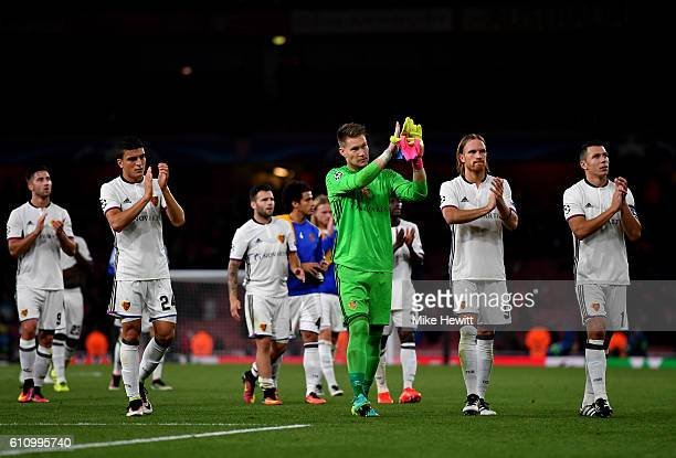 Basel players applaud the fans after the UEFA Champions League group A match between Arsenal FC and FC Basel 1893 at the Emirates Stadium on...