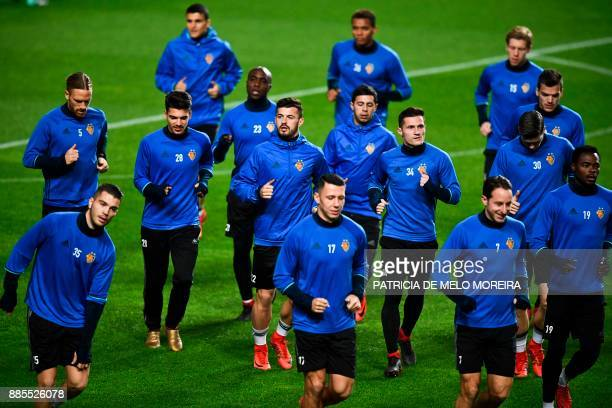 Basel players attend a training session at Luz stadium in Lisbon on December 4 on the eve of the Champions League match group A SL Benfica vs Basel /...