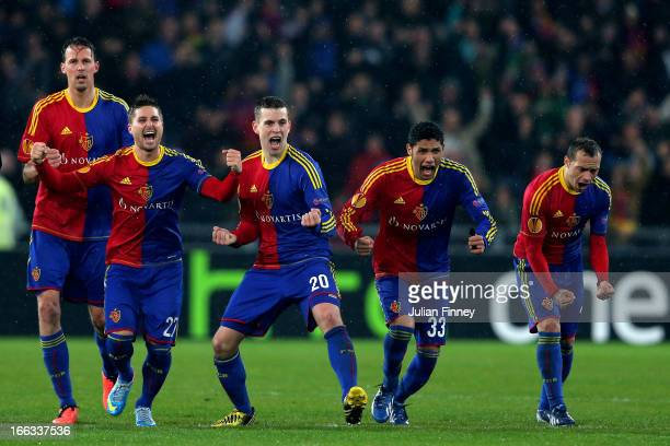 Basel players celebrate after teammate Marcelo Diaz scores the matchwinning penalty in the penalty shoot out during UEFA Europa League quarter final...