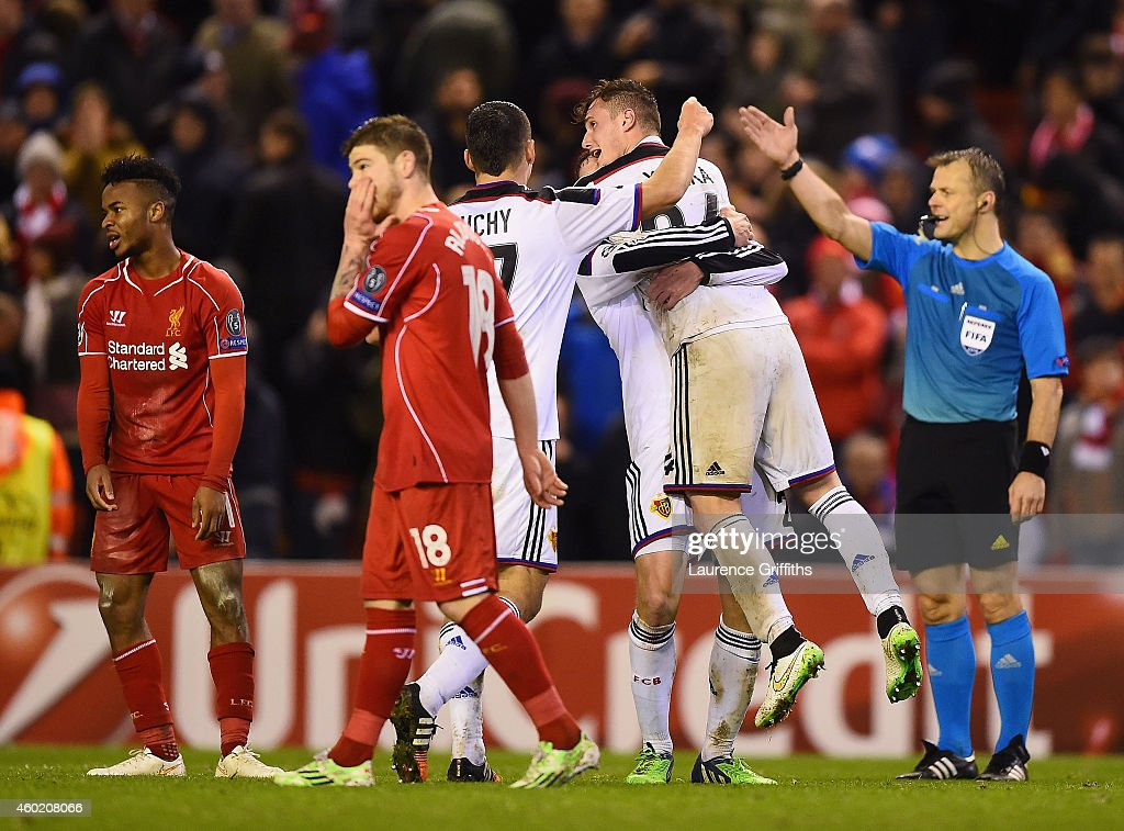 Basel players celebrate their team's 1-1 draw as the final whistle blows during the UEFA Champions League group B match between Liverpool and FC Basel 1893 at Anfield on December 9, 2014 in Liverpool, United Kingdom.