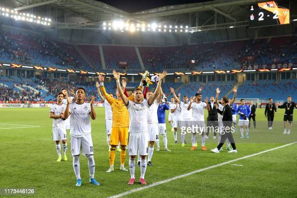 Basel players greet their fans after the UEFA Europa League group C football match between Trabzonspor and Basel at Medical Park Stadium in Trabzon,...
