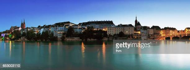 Basel skyline near Rhine River at blue hour - capital city of Switzerland