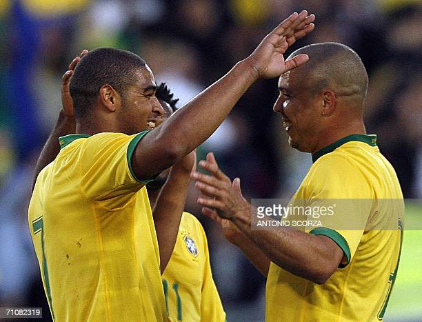Brazilian footbaler Adriano celebrates a goal with teammate Ronaldo against FC Lucern Selection during a friendly match at St Jakob stadium in Basel...