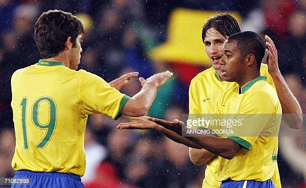 Brazilian footbaler Robinho celebrates with teammates Juninho Pernambucano and Edmilson their goal the seventh to Brazil against FC Lucern Selection...