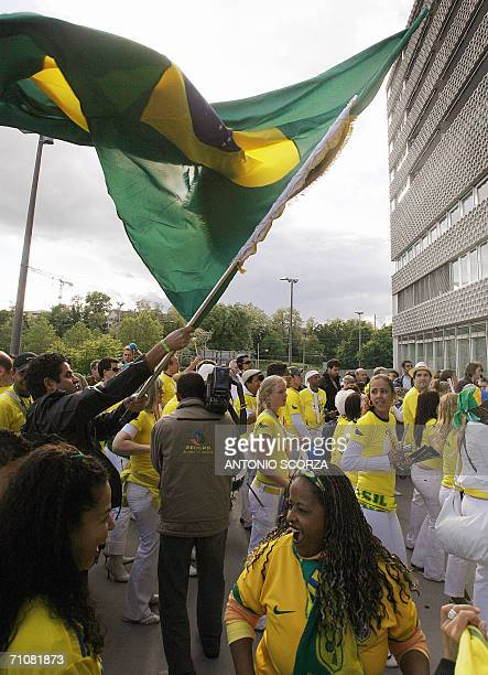 Brazilian football supporters wave the national flag while samba musicians play before the friendly match against the FC Lucern Selection at St Jakob...