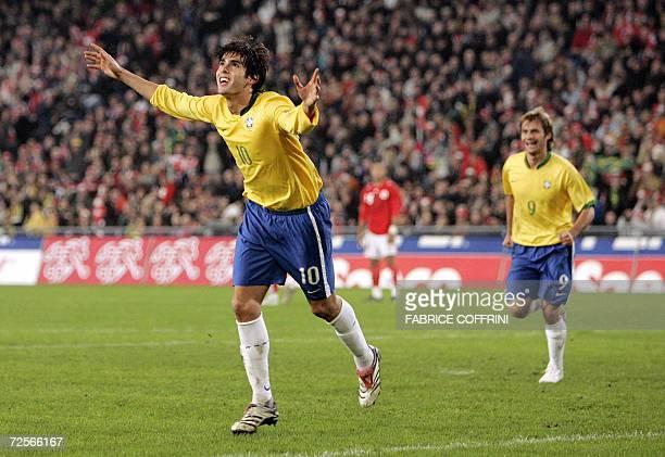 Brazilian midfielder Kaka celebrates followed by teammate Rafael Sobis after he scored against Switzerland during their friendly football match 15...