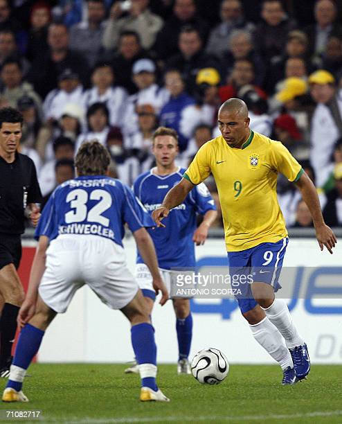 Brazilian Ronaldo Nazario tries to pass by Swiss Pirmin Schwegler of the FC Lucern Selection during a friendly match at St Jakob stadium in Basel 30...