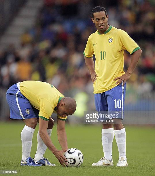 Brazil's defender Roberto Carlos adjusts the ball in front of teammate midfielder Ronaldinho during a friendly football game against FC Luzern...