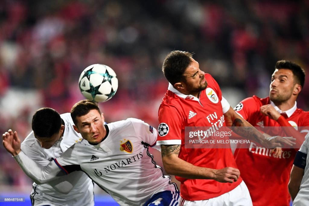 Basel's Albanian midfielder Taulant Xhaka (2ndL) heads the ball with Benfica's Brazilian defender Jardel Vieira (2ndR) during the UEFA Champions League football match SL Benfica vs FC Basel at the Luz stadium in Lisbon on December 5, 2017. /