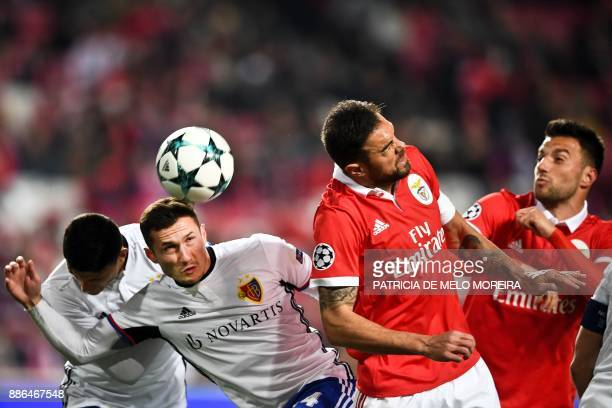 Basel's Albanian midfielder Taulant Xhaka heads the ball with Benfica's Brazilian defender Jardel Vieira during the UEFA Champions League football...