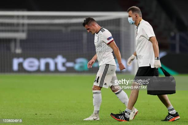FC Basel's Albanian midfielder Taulant Xhaka leaves the pitch after an injury during the UEFA Europa League quarterfinal football match Shakhtar...