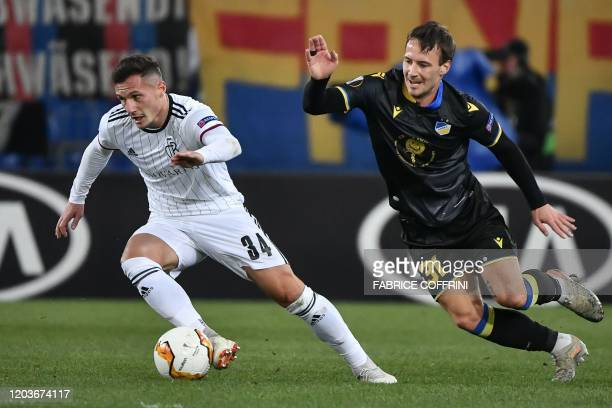 FC Basel's Albanian midfielder Taulant Xhaka vie for the ball with APOEL Nicosia's Danish midfielder Mike Jensen during the UEFA Europa League last...