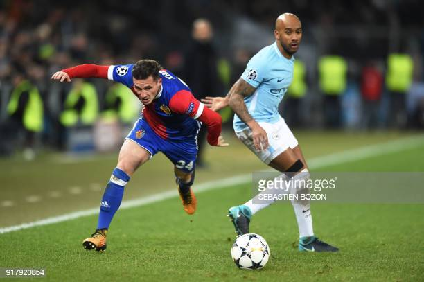 Basel's Albanian midfielder Taulant Xhaka vies for the ball with Manchester City's English midfielder Fabian Delph during the UEFA Champions League...