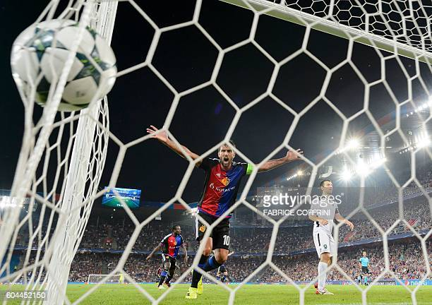 Basel's Argentinian midfielder Matias Delgado reacts after his teammate Swiss midfielder Renato Steffen scored the first goal of the team during the...