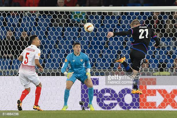 Basel's Austrian forward Marc Janko misses an action in front of Sevilla's goalkeeper David Soria and Sevilla's French defender Thimothee...