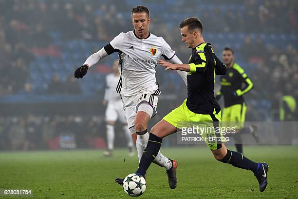 Basel's Austrian forward Marc Janko vies with Arsenal's English defender Rob Holding during the UEFA Champions league Group A football match between...