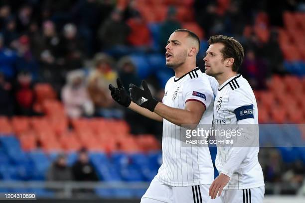 FC Basel's Brazilian forward Arthur Cabral gestures next to teammate Swiss midfielder Valentin Stocker during the UEFA Europa League Last 32 Second...
