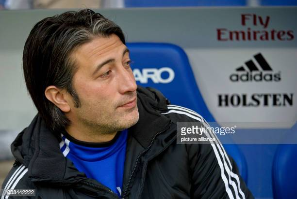 Basel's coach Murat Yakin sits on a bench at the tryout match between Hamburger SV and FC Basel in the Imtech Arena in Hambrug Germany 18 January...