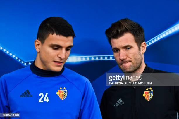 Basel's coach Raphael Wicky and Basel's Norwegian midfielder Mohamed Elyounoussi arrive to give a press conference at Luz stadium in Lisbon on...