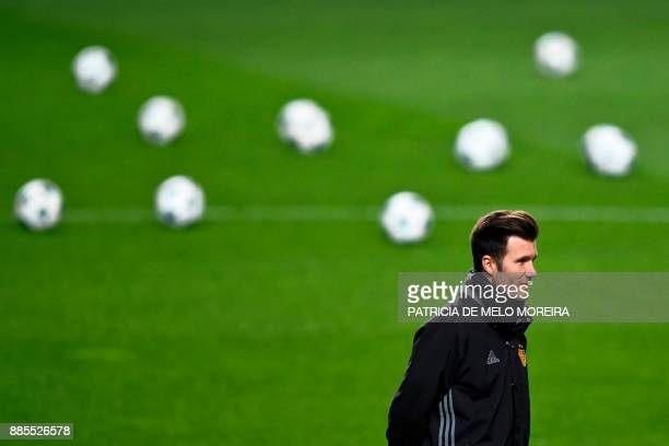 Basel's coach Raphael Wicky attends a training session at Luz stadium in Lisbon on December 4 on the eve of the Champions League match group A SL...
