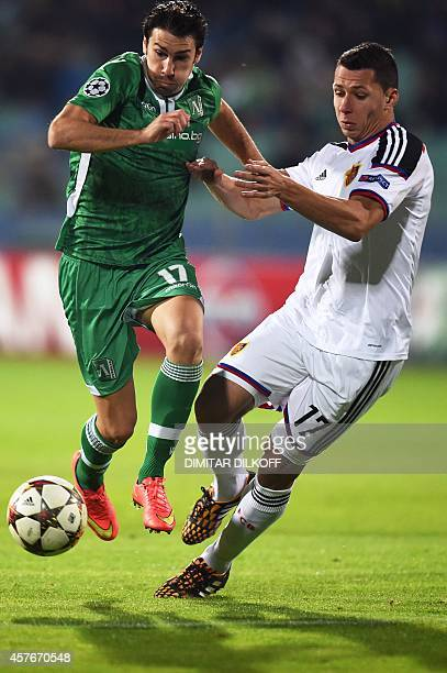 Basel's Czech defender Marek Suchy vies for the ball with Ludogorets Razgrad's Spanish midfielder Dani Abalo during the UEFA Champions League Group B...