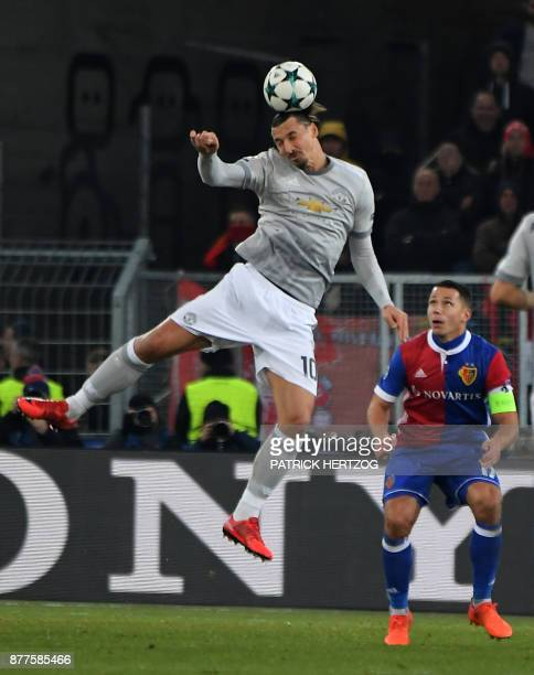Basel's Czech defender Marek Suchy vies with Manchester United's Swedish forward Zlatan Ibrahimovic during the UEFA Champions League Group A football...