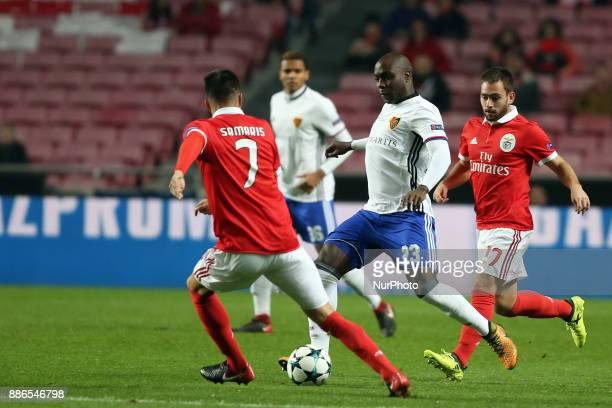 Basel's defender Eder Balanta from Colombia vies with Benfica's Greek midfielder Andreas Samaris and Benfica's Serbian midfielder Andrija Zivkovic...