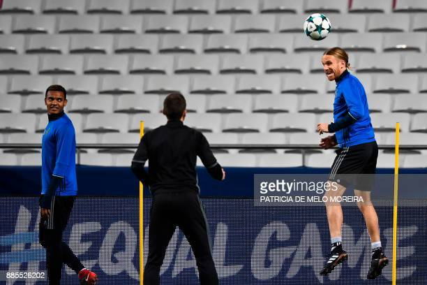Basel's defender Michael Lang heads the ball during a training session at Luz stadium in Lisbon on December 4 on the eve of the Champions League...