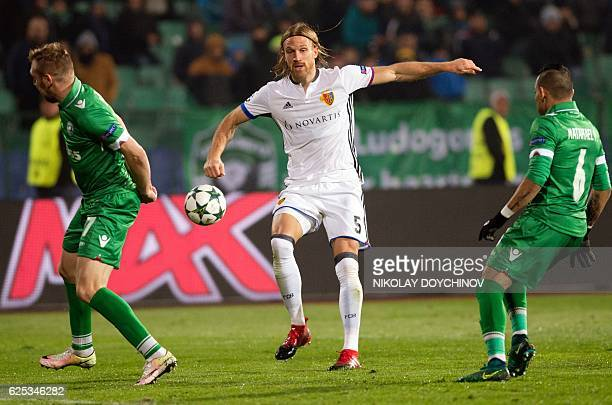 Basel's defender Michael Lang shoots during the UEFA Champions League group A football match between PFC Ludogorets Razgrad and FC Basel 1893 at the...
