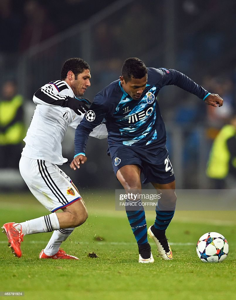 Basel's Egyptian midfielder Mohamed Elneny (L) vies with Porto's Brazilian defender Alex Sandro during the UEFA Champions League round of 16 first leg football match between Basel (FCB) and Porto (FCP) on February 18, 2015 at the St. Jakob-Park stadium in Basel.