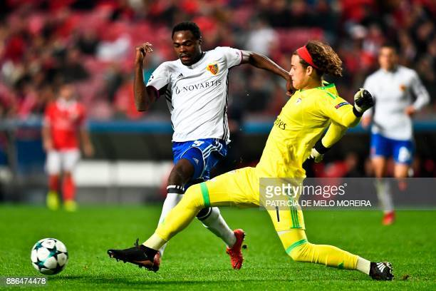 Basel's forward Dimitri Oberlin challenges Benfica's Belgian goalkeeper Mile Svilar during the UEFA Champions League football match SL Benfica vs FC...