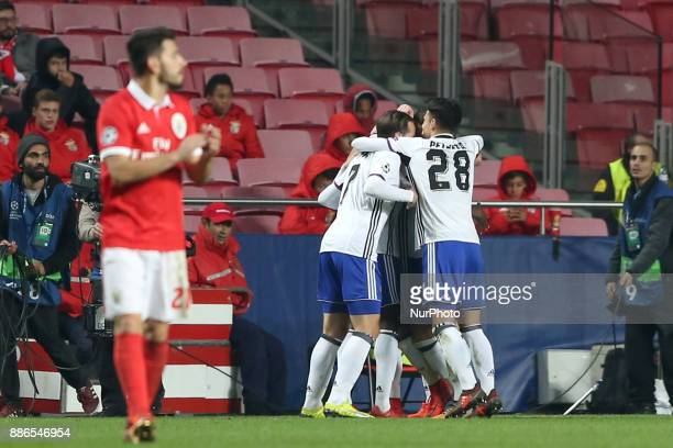 Basel's forward Dimitri Oberlin from Suisse celebrates with teammates after scoring during the UEFA Champions League Group A football match between...