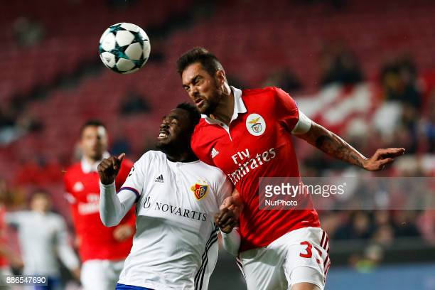 Basel's forward Dimitri Oberlin vies for the ball with Benfica's defender Jardel Vieira during Champions League 2017/18 match between SL Benfica vs...