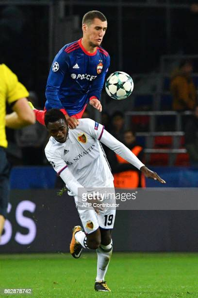 Basel's forward from Switzerland Dimitri Oberlin and CSKA Moscow's defender from Russia Viktor Vasin vie for the ball during the UEFA Champions...