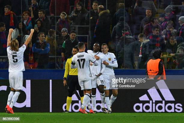Basel's forward from Switzerland Dimitri Oberlin celebrates with teammates after scoring the team's second goal during the UEFA Champions League...