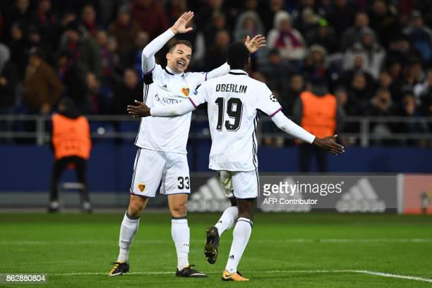 Basel's forward from Switzerland Dimitri Oberlin celebrates with Basel's midfielder from Switzerland Kevin Bua after scoring the team's second goal...