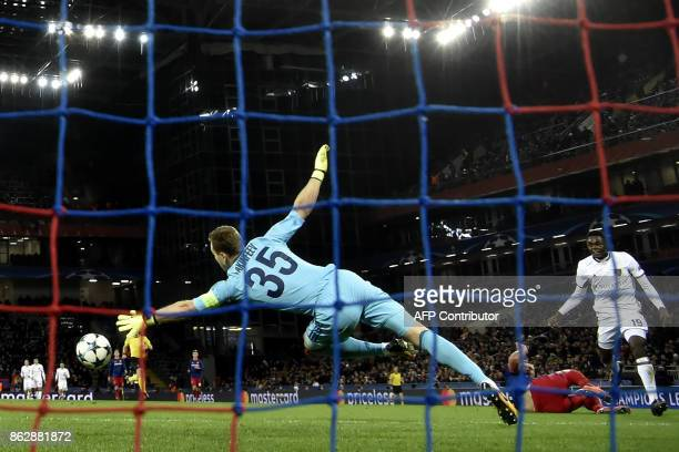 Basel's forward from Switzerland Dimitri Oberlin scores past CSKA Moscow's goalkeeper from Russia Igor Akinfeev during the UEFA Champions League...