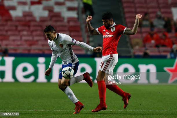 Basel's forward Mohamed Elyounoussi vies for the ball with Benfica's forward Gabriel Barbosa during Champions League 2017/18 match between SL Benfica...