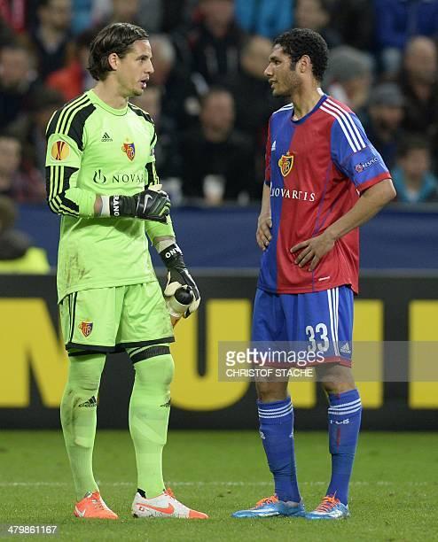 Basel's goalkeeper Yann Sommer and Basel's Egyptian midfielder Mohamed Elneny talk during the UEFA Europa League round of 16 second leg football...