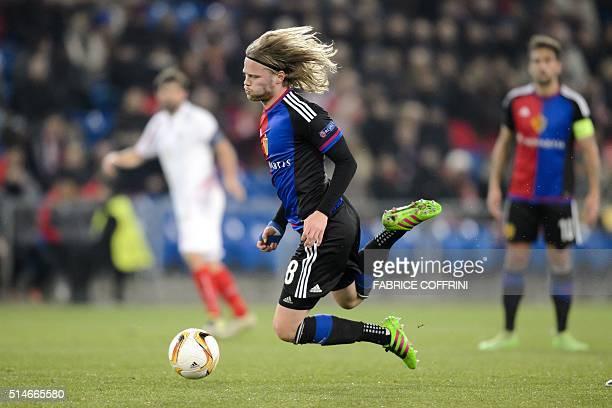 Basel's Icelandic midfielder Birkir Bjarnason tries to controls the ball during the UEFA Europa League round of 16 first leg football match between...