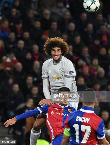 Basel's Italian defender Raoul Petretta vies with Manchester United's Belgian midfielder Marouane Fellaini during the UEFA Champions League Group A...