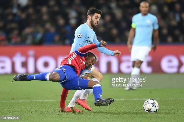 Basel's Ivorian midfielder Geoffroy Serey Die vies for the ball with Manchester City's Portuguese midfielder Bernardo Silva during the UEFA Champions...