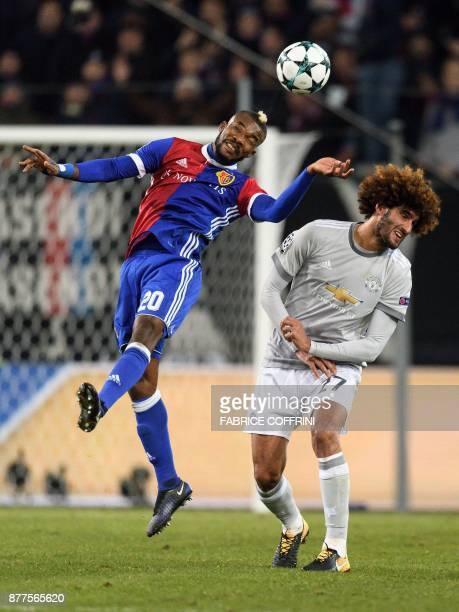 Basel's Ivorian midfielder Geoffroy Serey Die vies with Manchester United's Belgian midfielder Marouane Fellaini during the UEFA Champions League...
