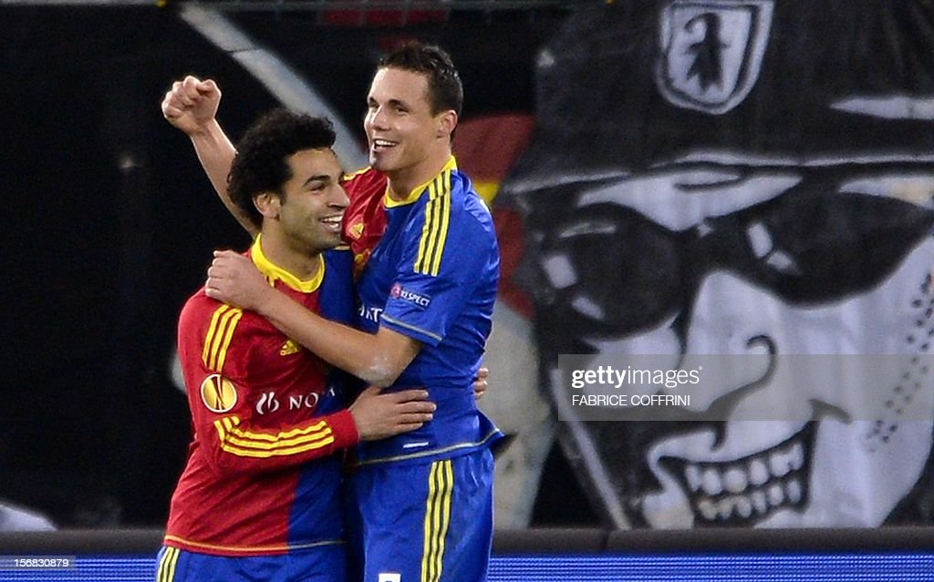 FC Basel's midfielder David Degen (R) who scored the team's third goal is congratulated by temmate Egyptian midfielder Mohamed Salah during their Europa League UEFA Europa League Group G football match between FC Basel and Sporting Clube de Portugal on November 22, 2012 in Basel.