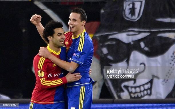 FC Basel's midfielder David Degen who scored the team's third goal is congratulated by temmate Egyptian midfielder Mohamed Salah during their Europa...