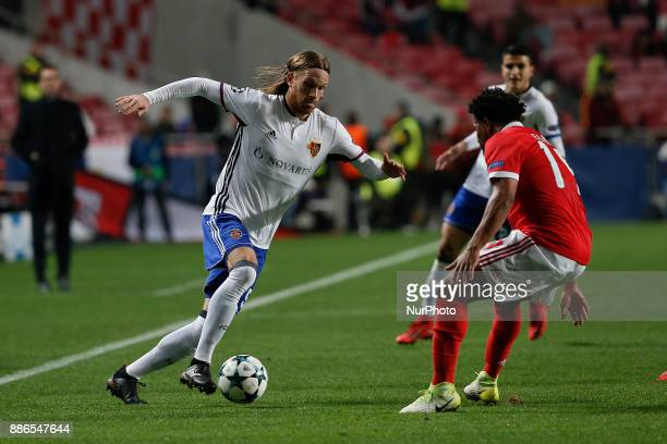 Basel's midfielder Michael Lang vies for the ball with Benfica's defender Eliseu during Champions League 2017/18 match between SL Benfica vs FC Basel...