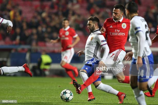 Basel's midfielder Renato Steffen from Suisse fights for the ball with Benfica's Greek midfielder Andreas Samaris during the UEFA Champions League...