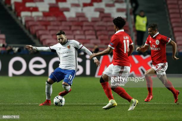 Basel's midfielder Renato Steffen vies for the ball with Benfica's defender Eliseu and Benfica's forward Diogo Goncalves during Champions League...