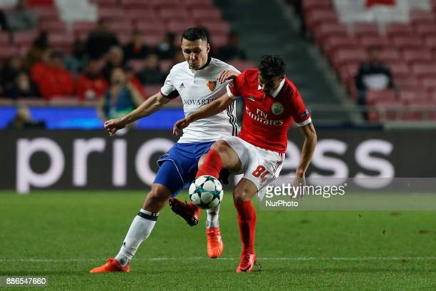 Basel's midfielder Renato Steffen vies for the ball with Benfica's forward Diogo Goncalves during Champions League 2017/18 match between SL Benfica...