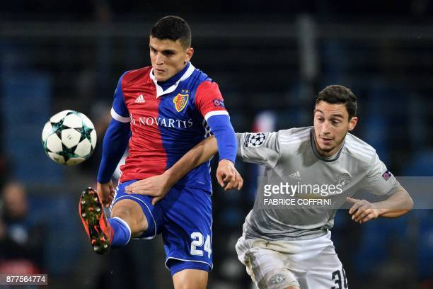 Basel's Norwegian midfielder Mohamed Elyounoussi vies with Manchester United's Italian defender Matteo Darmian during the UEFA Champions League Group...